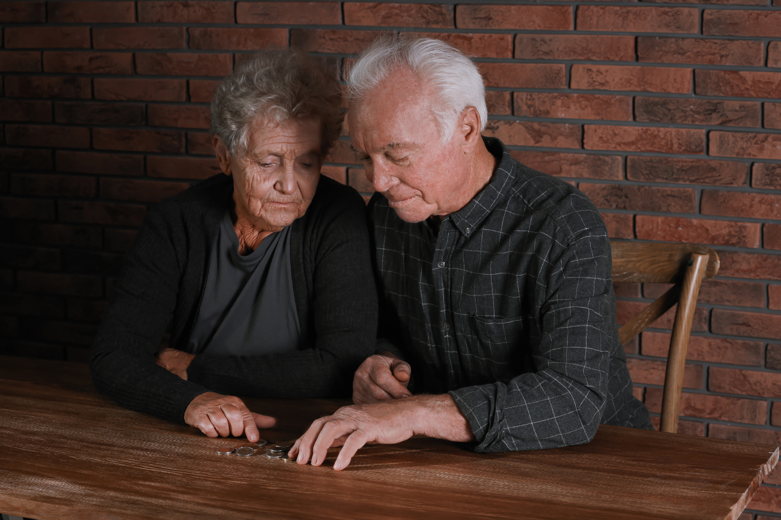 Poor Old Couple Counting Money